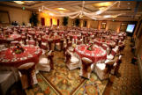 Grand ballroom set for a wedding reception and banquet.